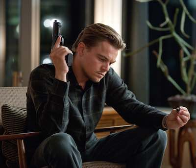 Inception - Leonardo DiCaprio sitting with gun