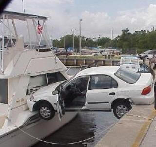 car crashes into boat
