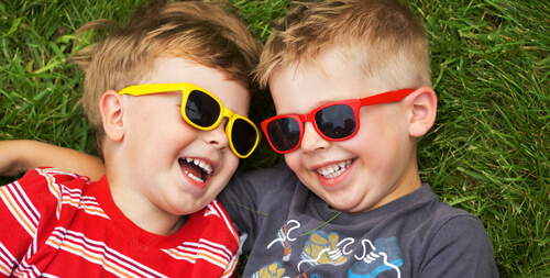 kids in sunglasses smiling